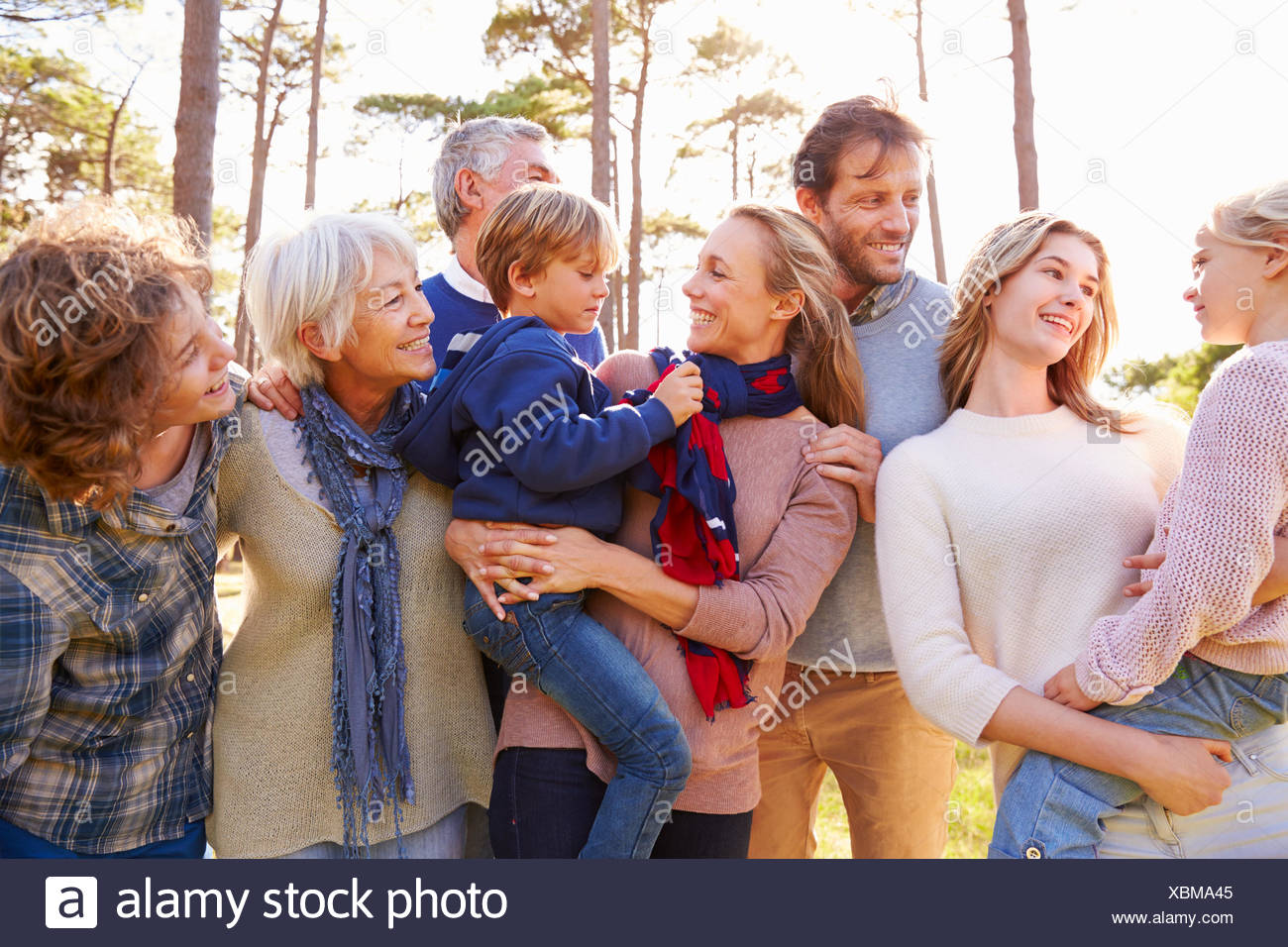 Happy multi-generation family in the countryside - Stock Image