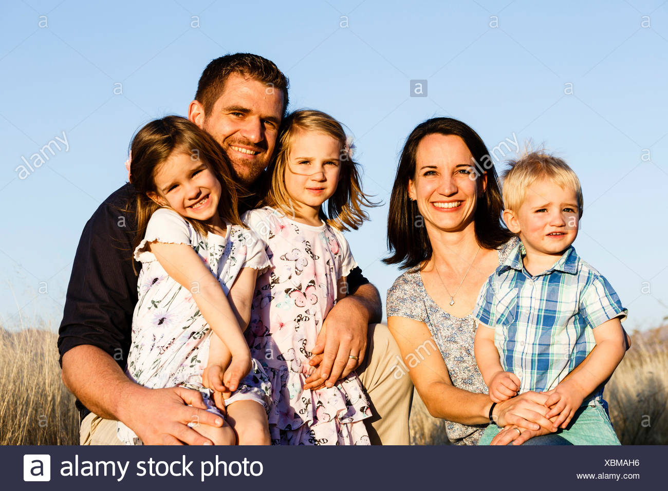 Family portrait, parents with three small children, Namibia - Stock Image