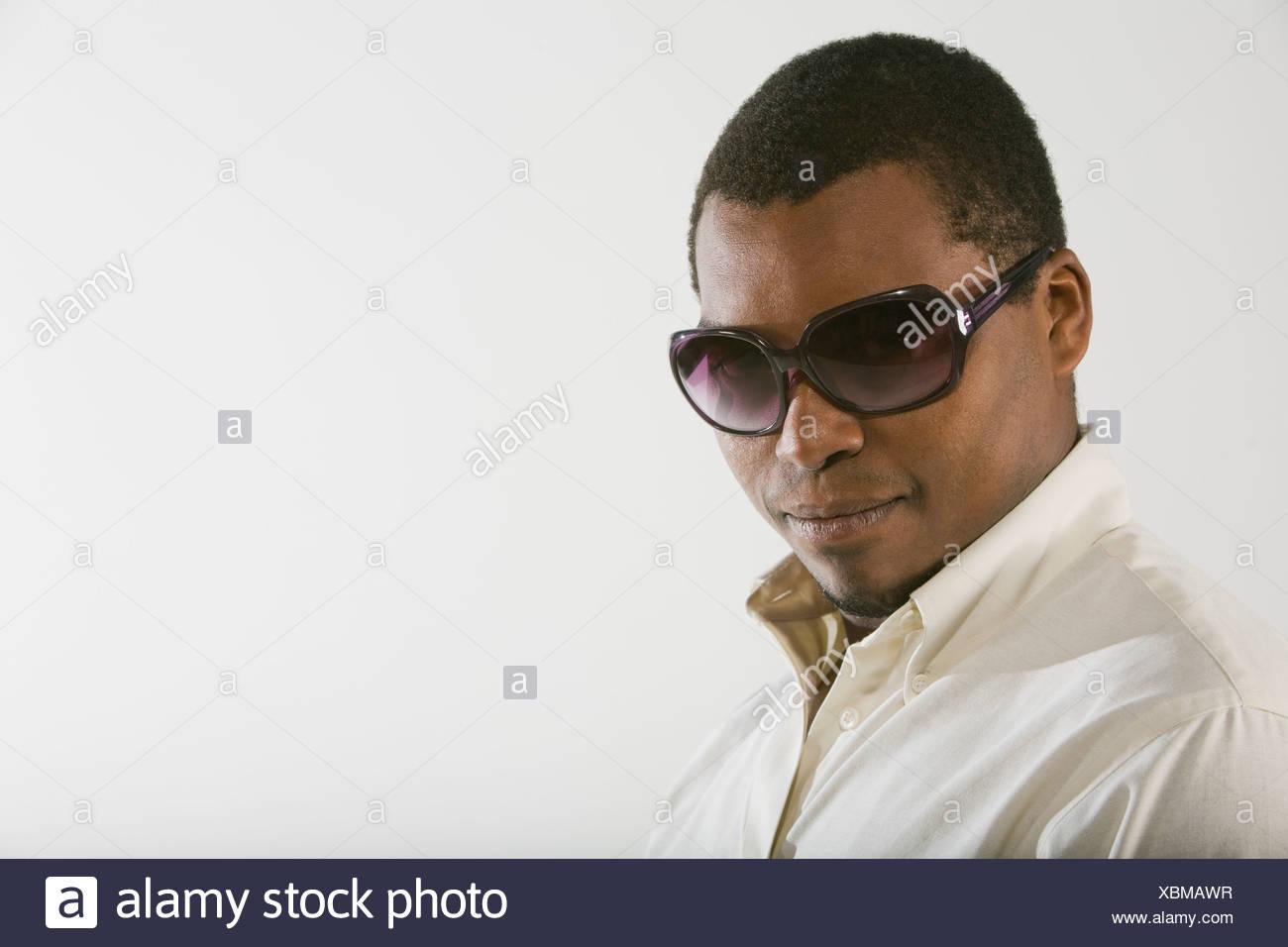 b93cb138e198 Side profile of a mid adult man wearing sunglasses Stock Photo ...