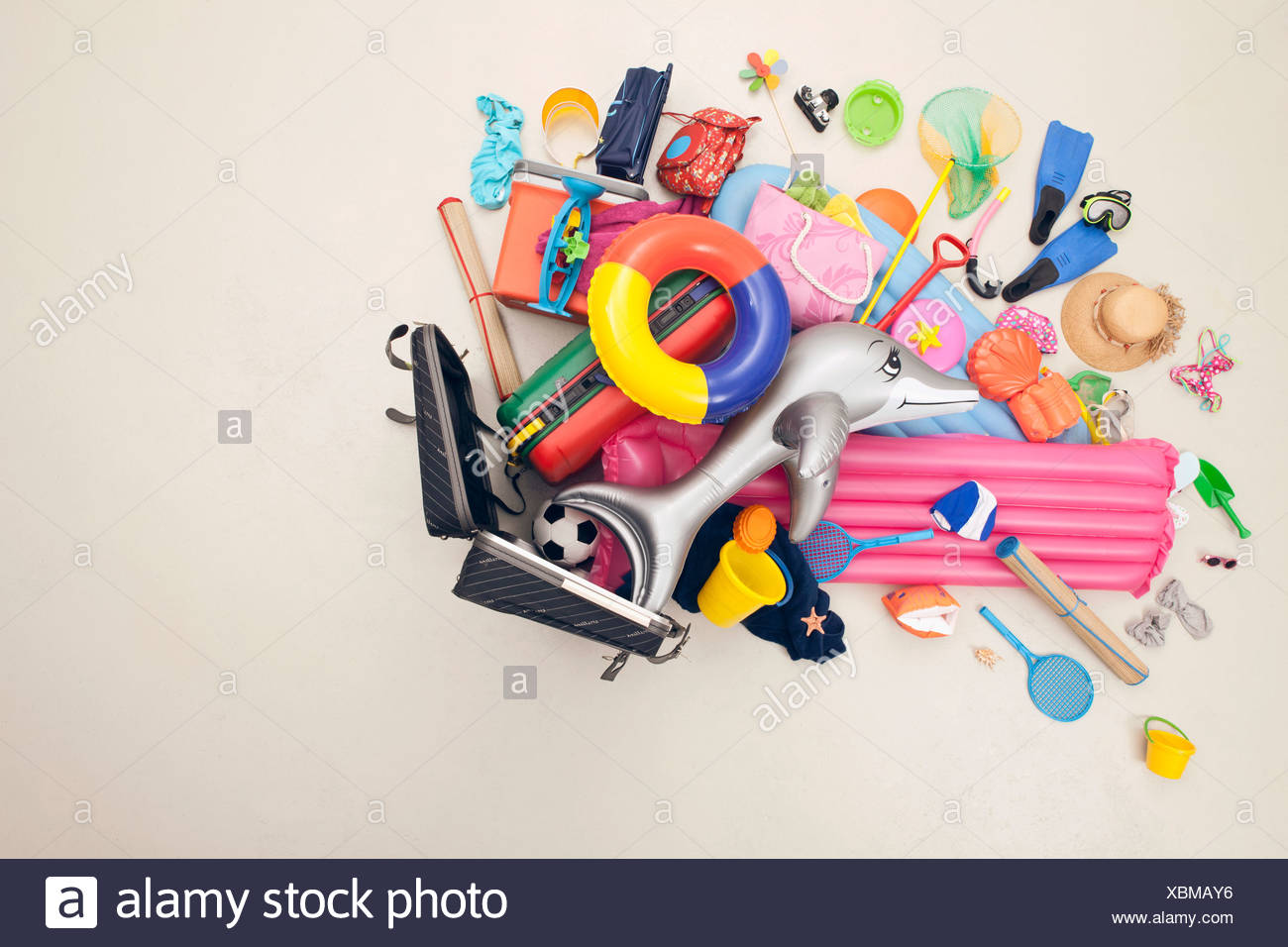 Germany, Artificial scene with beach toys coming out of baggage - Stock Image