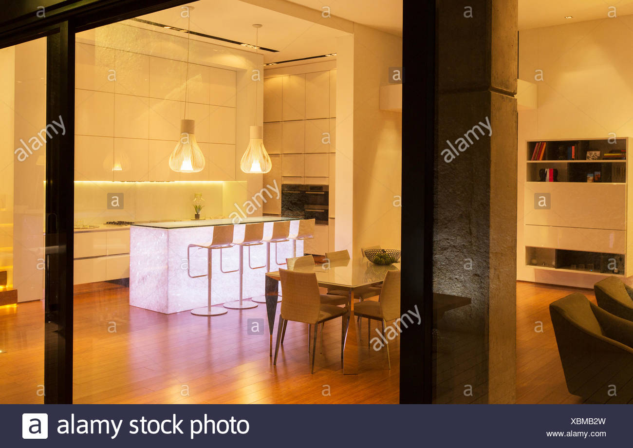 Kitchen and dining area in modern house - Stock Image