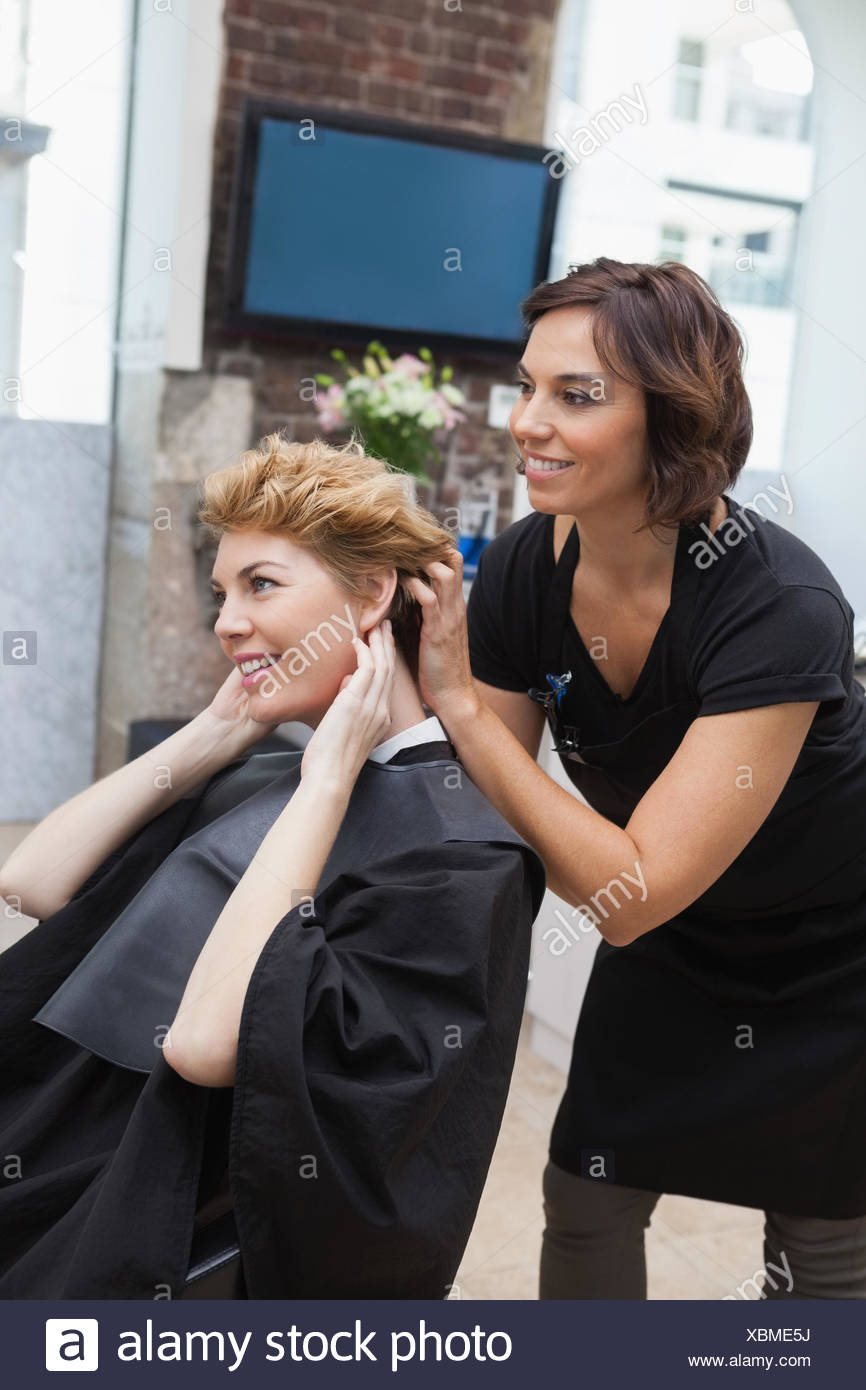 Hairdresser cutting a customers hair Stock Photo