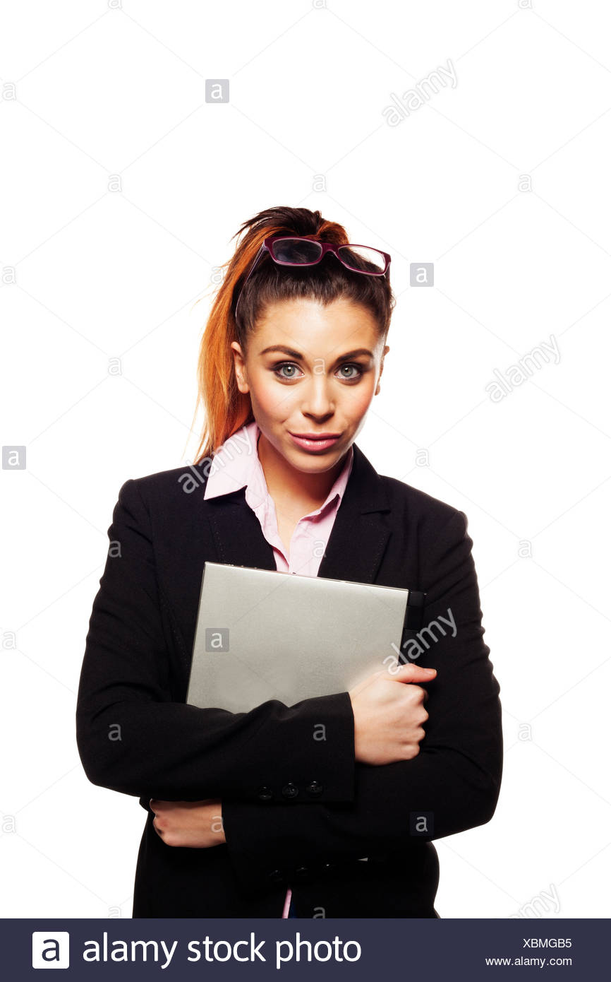Businesswoman clutching her laptop - Stock Image