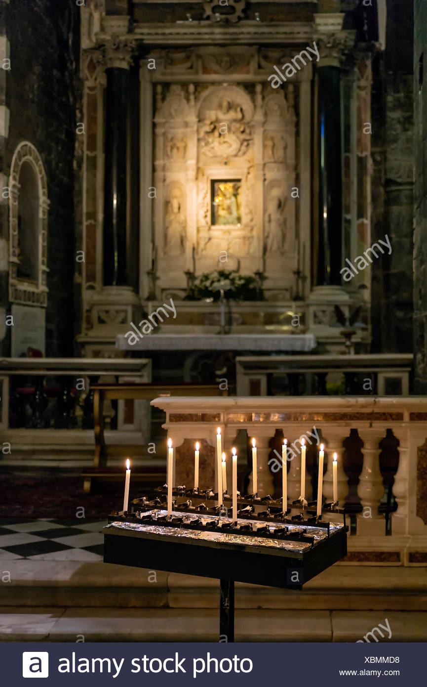 Alter with votive candles, San Lorenzo church, Porto Venere, Italy - Stock Image