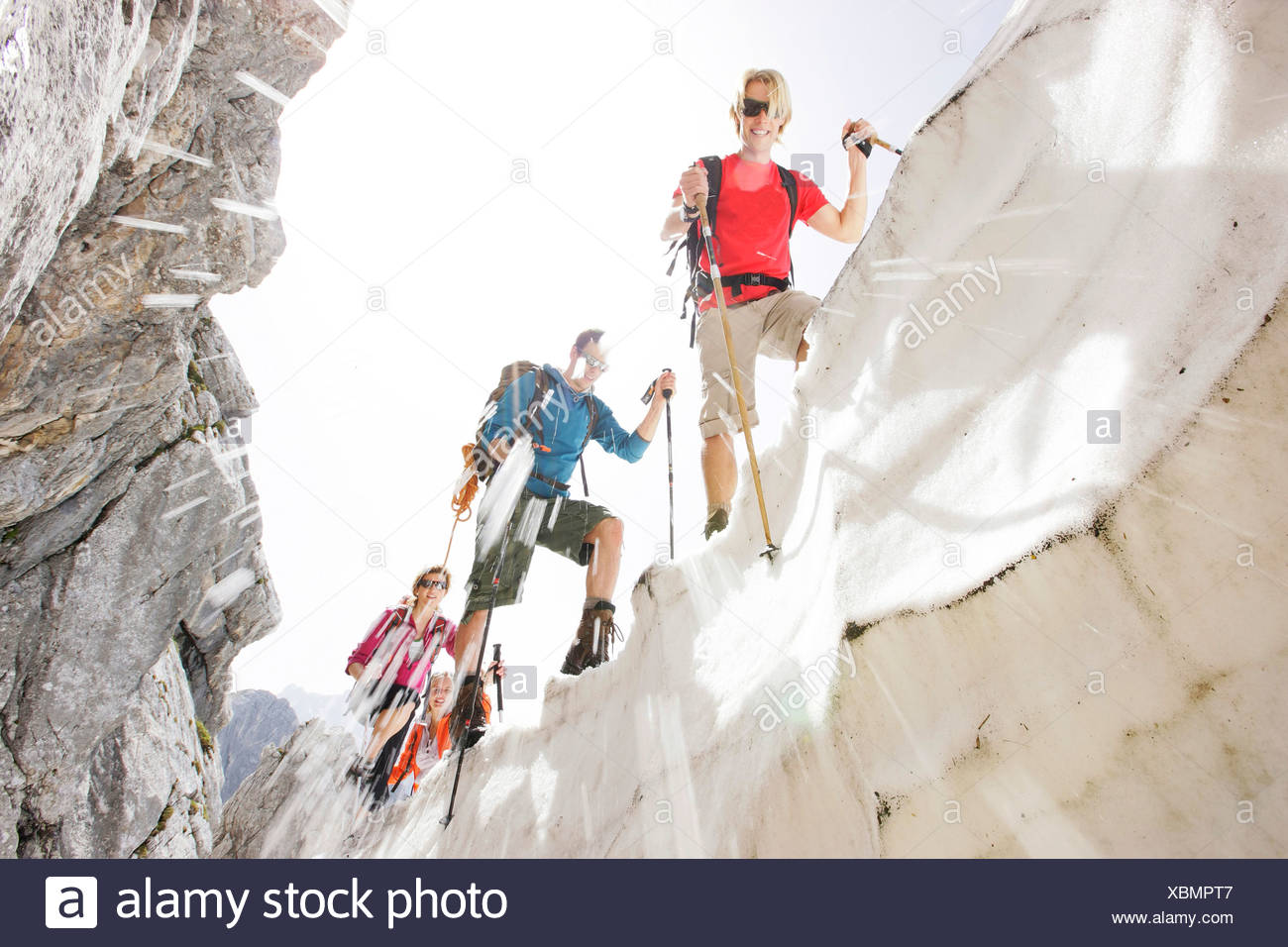 Hikers on cornice, Werdenfelser Land, Bavaria, Germany - Stock Image