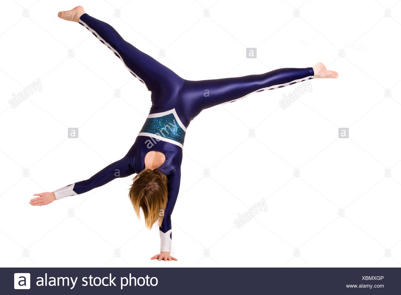 Standing on one hand - Stock Image