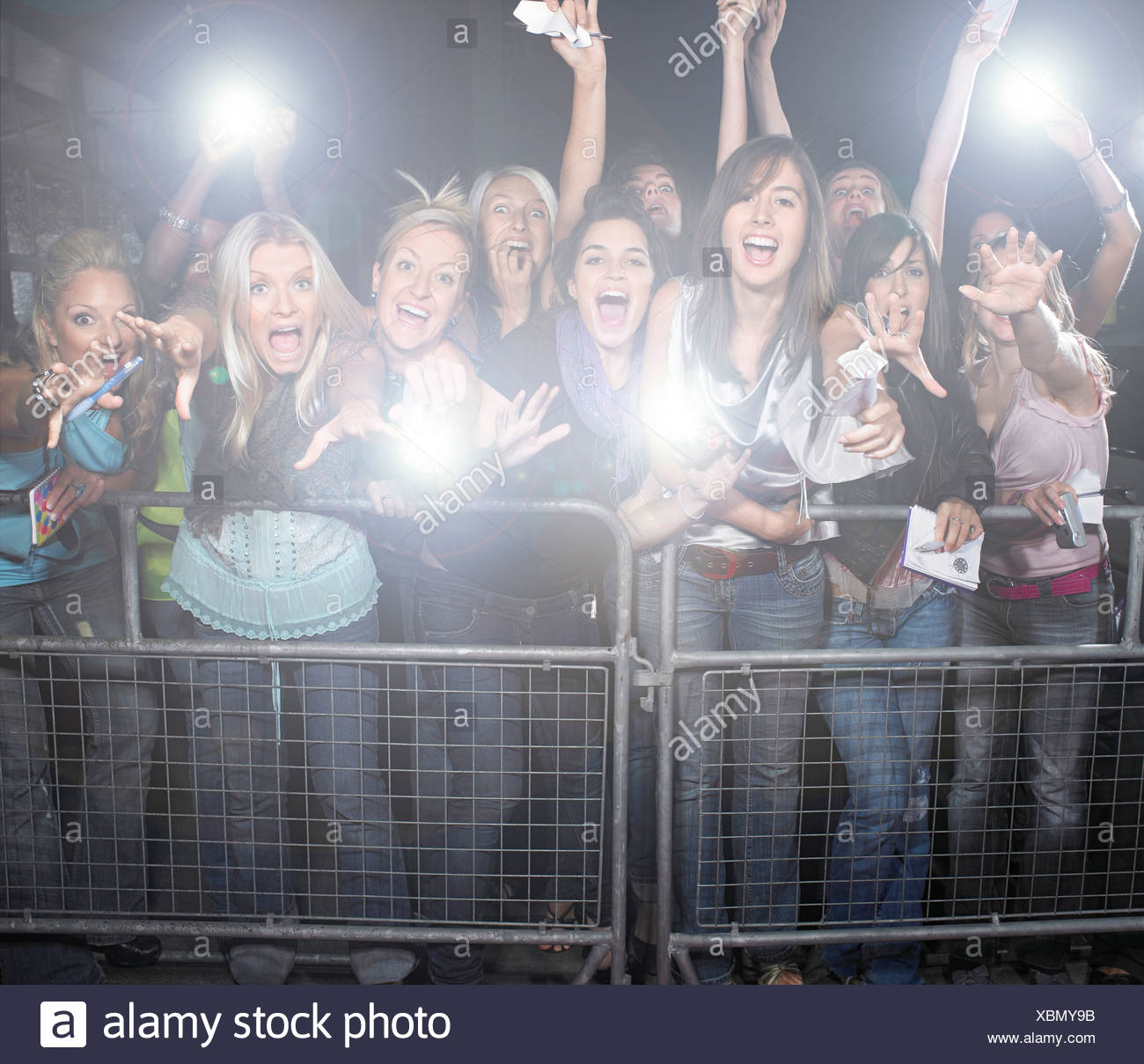 Crowd of young female fans screaming cheering t concert - Stock Image