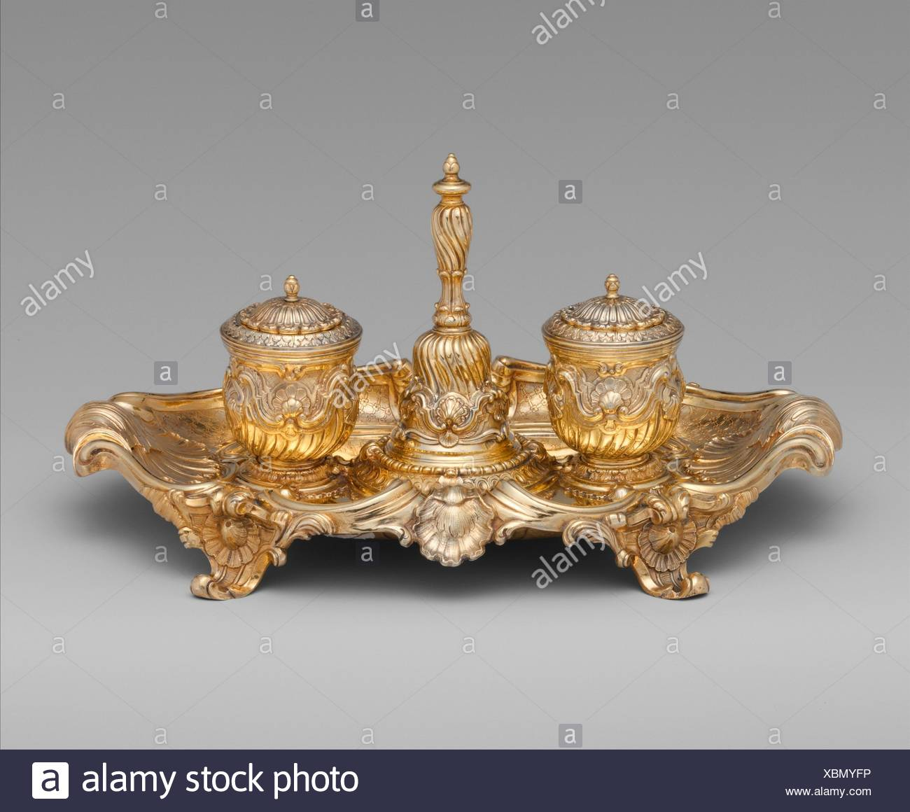 Inkstand. Maker: Probably by Andrea Boucheron (ca. 1701?-1761); Date: ca. 1753; Culture: Italian, Turin; Medium: Silver gilt; Dimensions: 6 x 13 in. - Stock Image