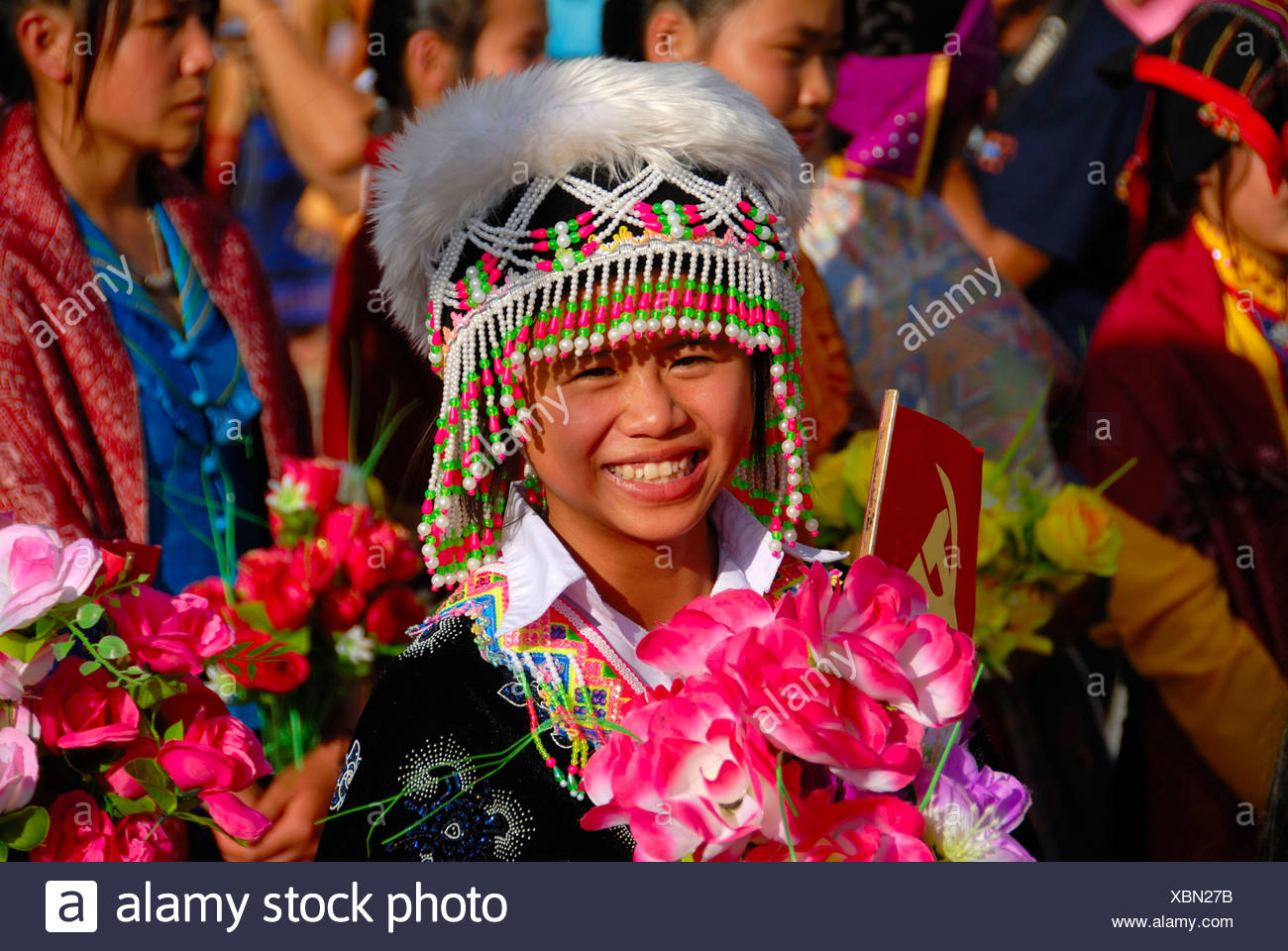 Festival, young Hmong woman, portrait, dressed in traditional clothing, colourful headwear, Xam Neua, Houaphan province, Laos,  - Stock Image