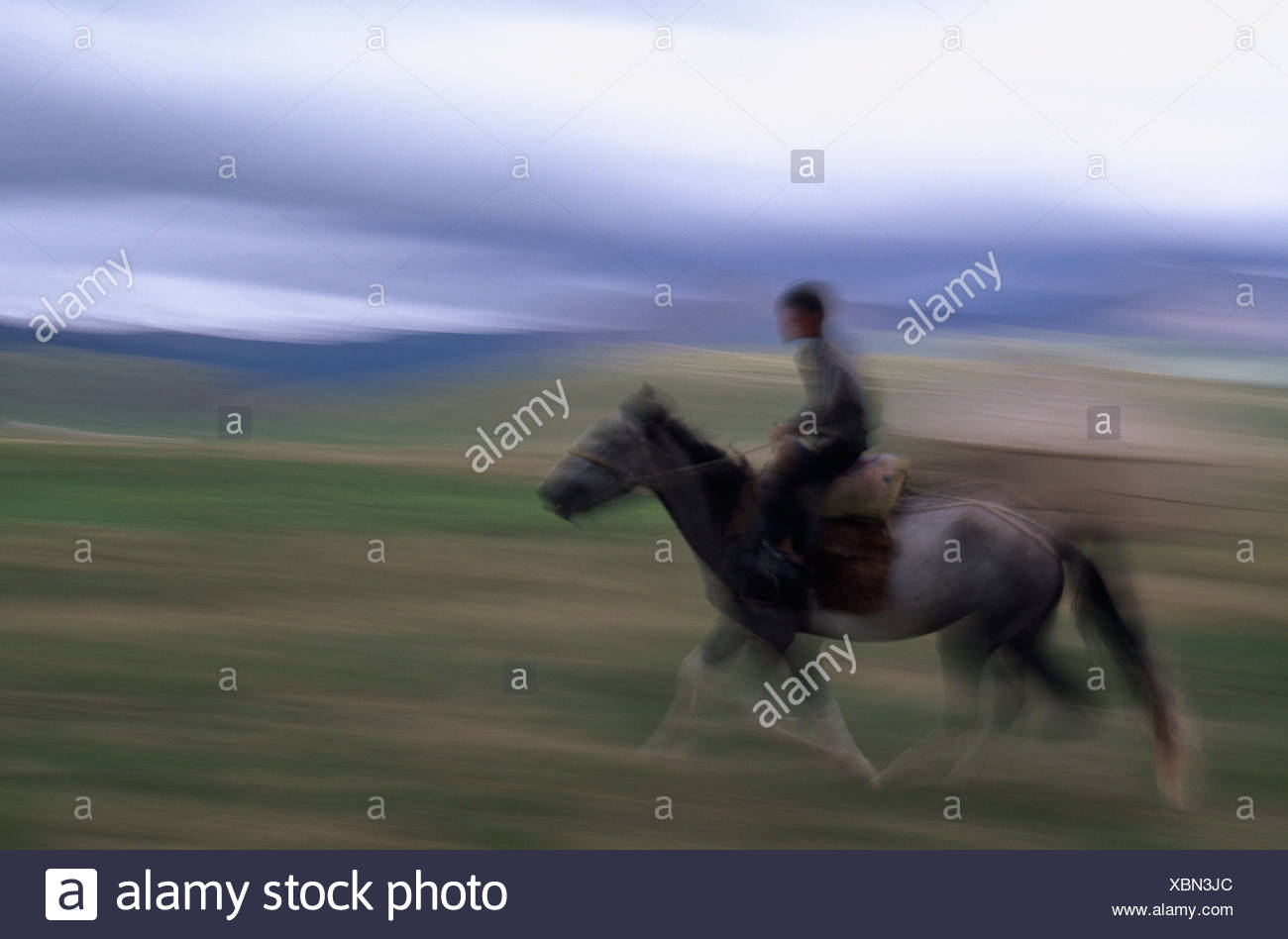 Nomad boy riding a horse, Song-Kul, Kyrgyzstan, Central Asia - Stock Image