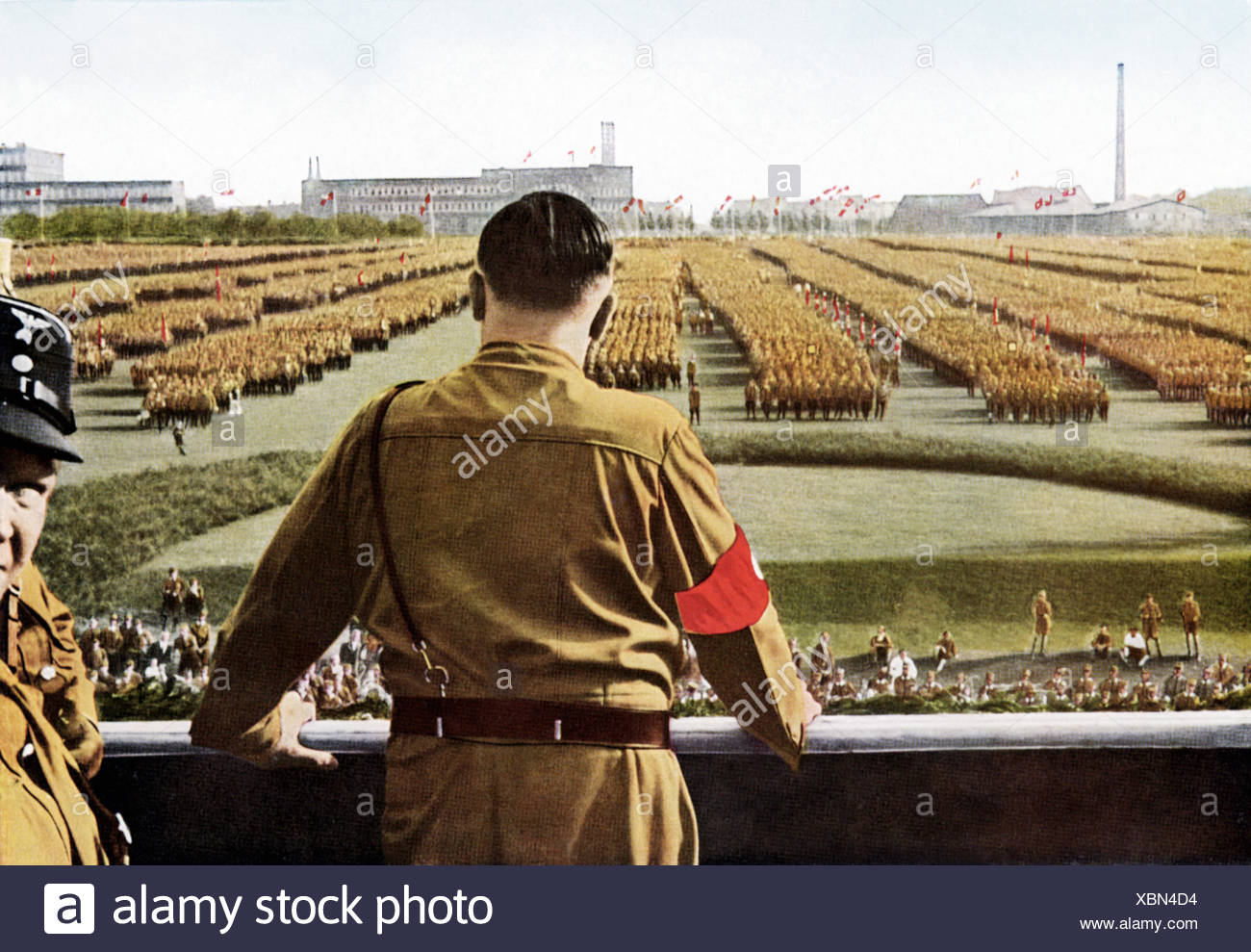 Hitler, Adolf, 20.4.1889 - 30.4.1945, German politician (NSDAP), Fuehrer and Chancellor of the Reich 30.1.1933 - 30.4.1945, half length, addressing members of the storm troopers (SA), Dortmund, 1933, Additional-Rights-Clearances-NA - Stock Image