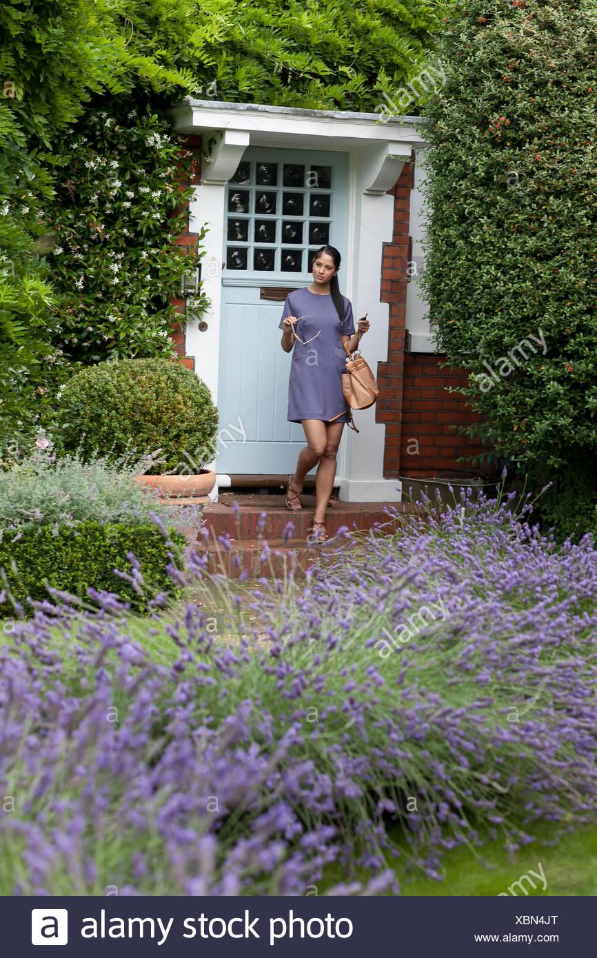 Woman Leaving Through Front Door