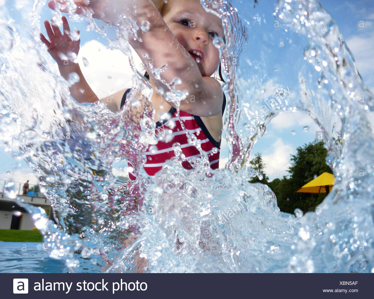 girl,paddle,resort swimming pool - Stock Image