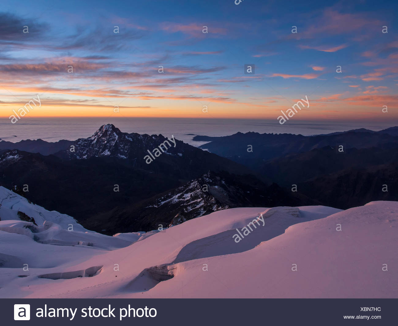 Glacier at sunset, Huayna Potosi, Cordillera Real, Bolivia - Stock Image