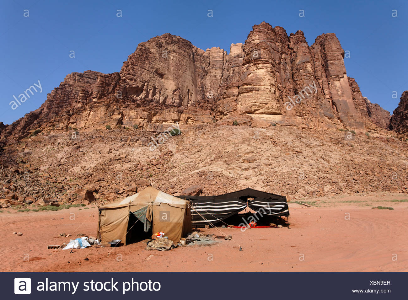 Mountain with Lawrence's Spring, Bedouin camp, Lawrence of Arabia, desert, Wadi Rum, Hashemite Kingdom of Jordan, Middle East - Stock Image