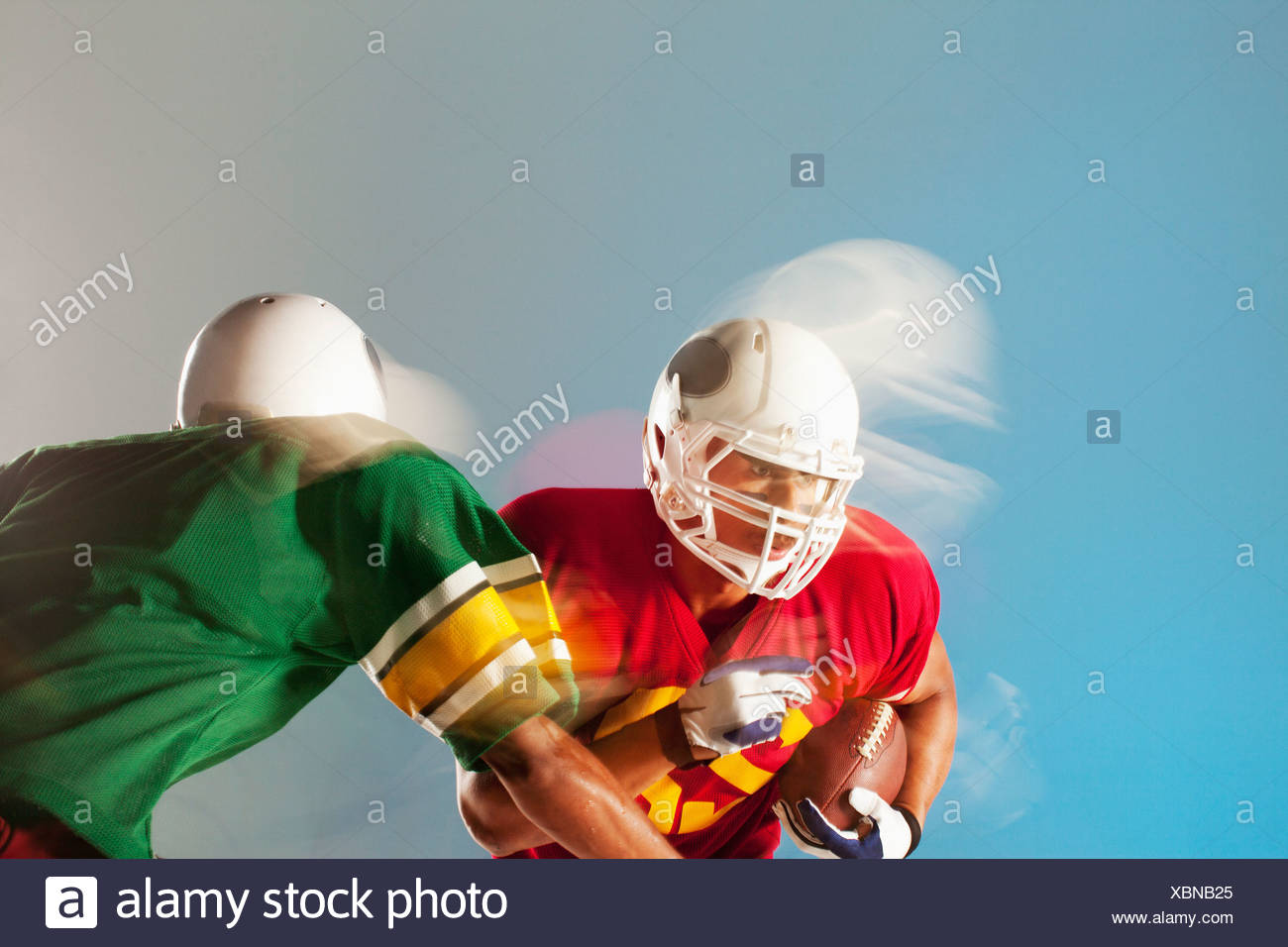 Blurred view of football players with ball - Stock Image