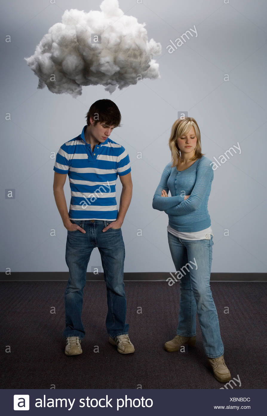 Male and female standing apart fighting - Stock Image