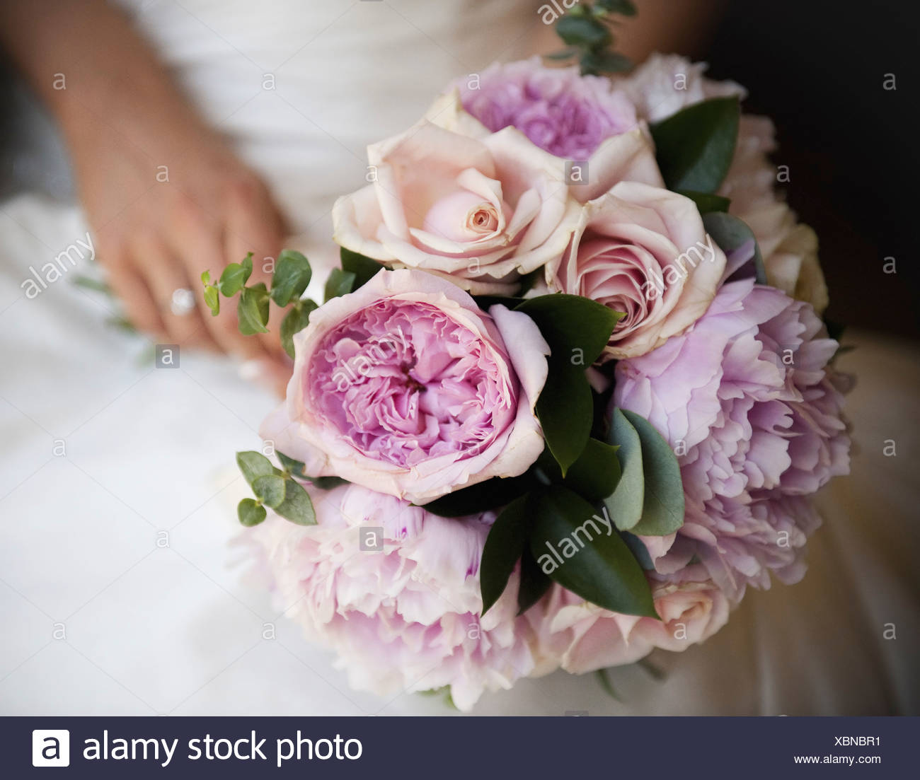 Wwwbouquet Sposait.A Bride Holding A Wedding Bouquet Of Roses And Peonies Pink And