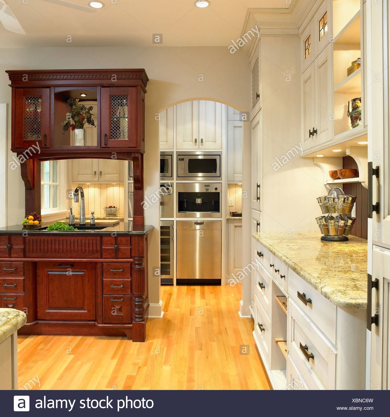 Traditional Kitchen With Cream Cabinets And Built In Dark Wood Hutch Victoria Vancouver Island British Columbia Canada Stock Photo Alamy