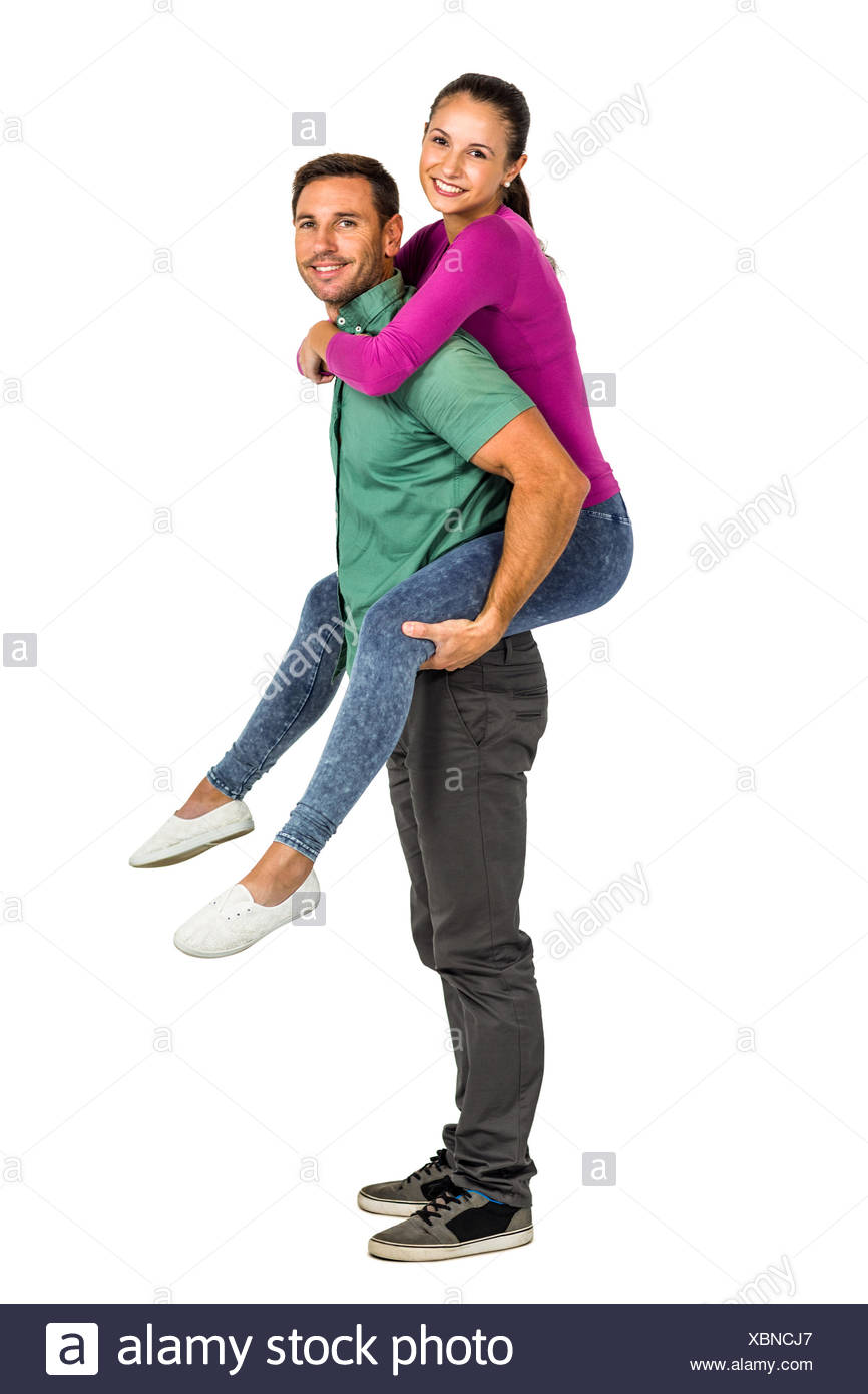Smiling couple giving piggy back - Stock Image
