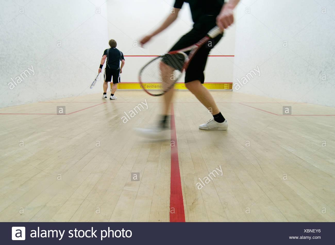 Two men playing squash - Stock Image