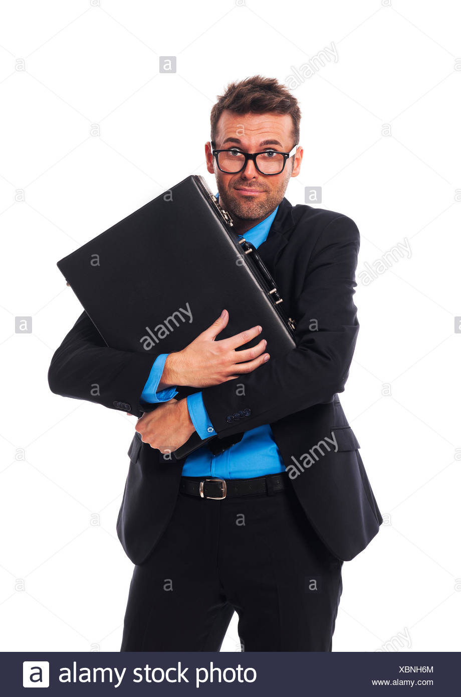 Frightened man firmly clutching his briefcase Debica, Poland - Stock Image