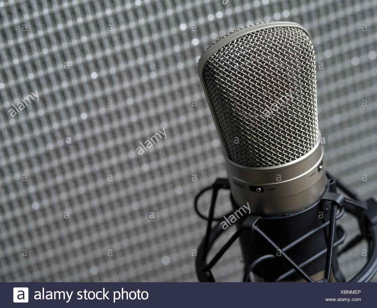 Condenser microphone and guitar amplifier - Stock Image