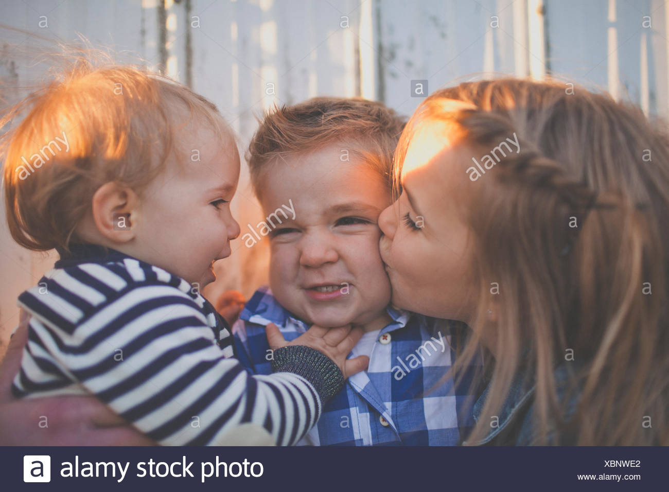 Young sibblings interact with each other. - Stock Image