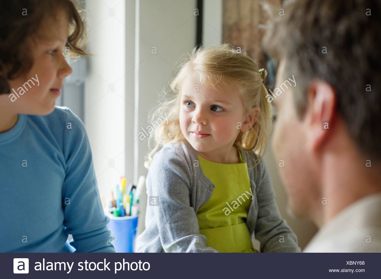 Man with his children at home - Stock Image