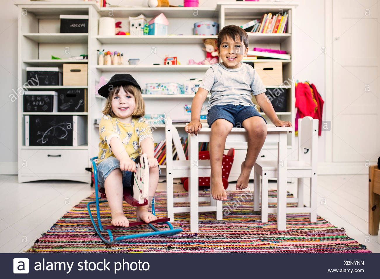 Children (2-3) smiling and looking at camera - Stock Image
