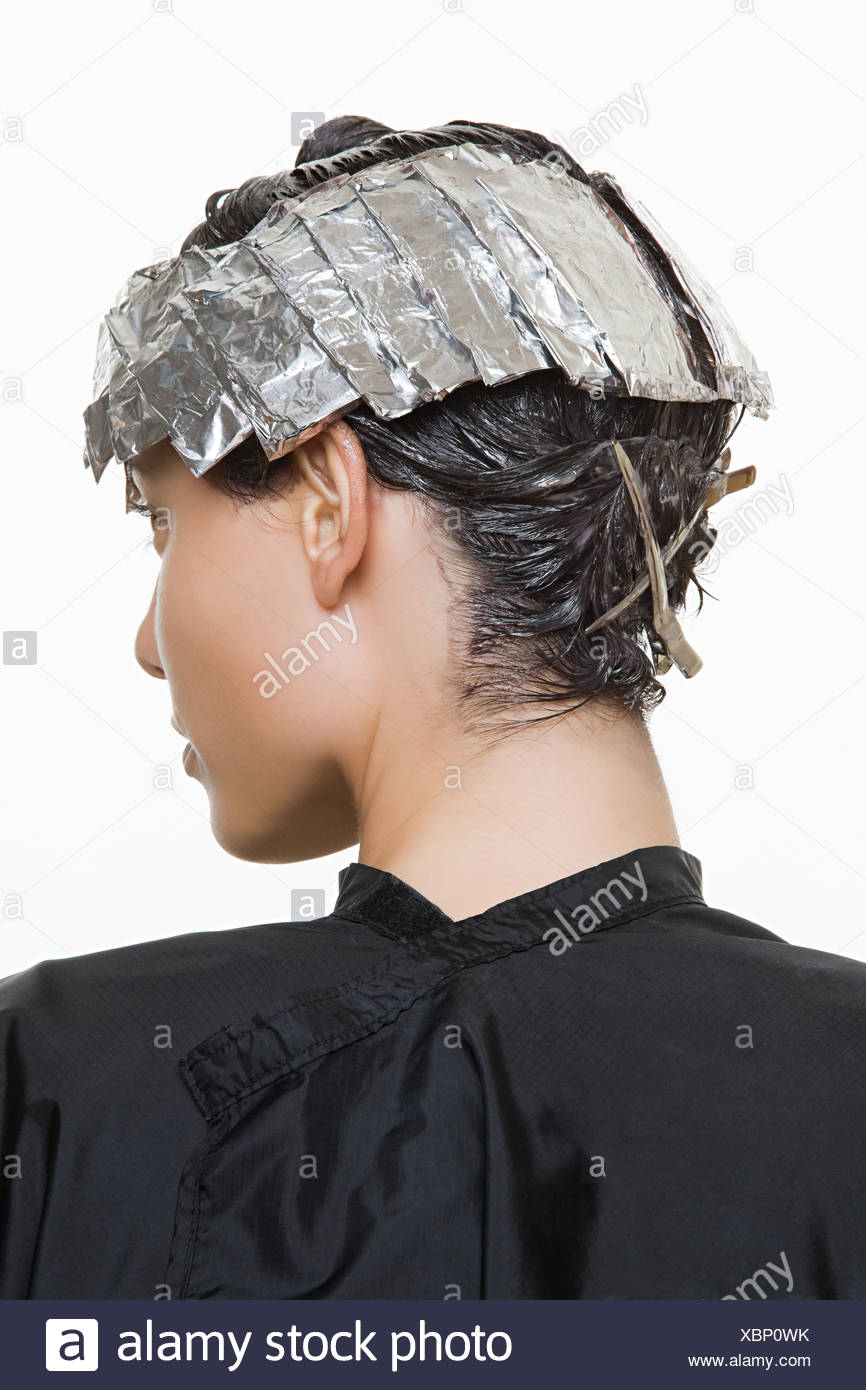 A woman having her hair dyed - Stock Image