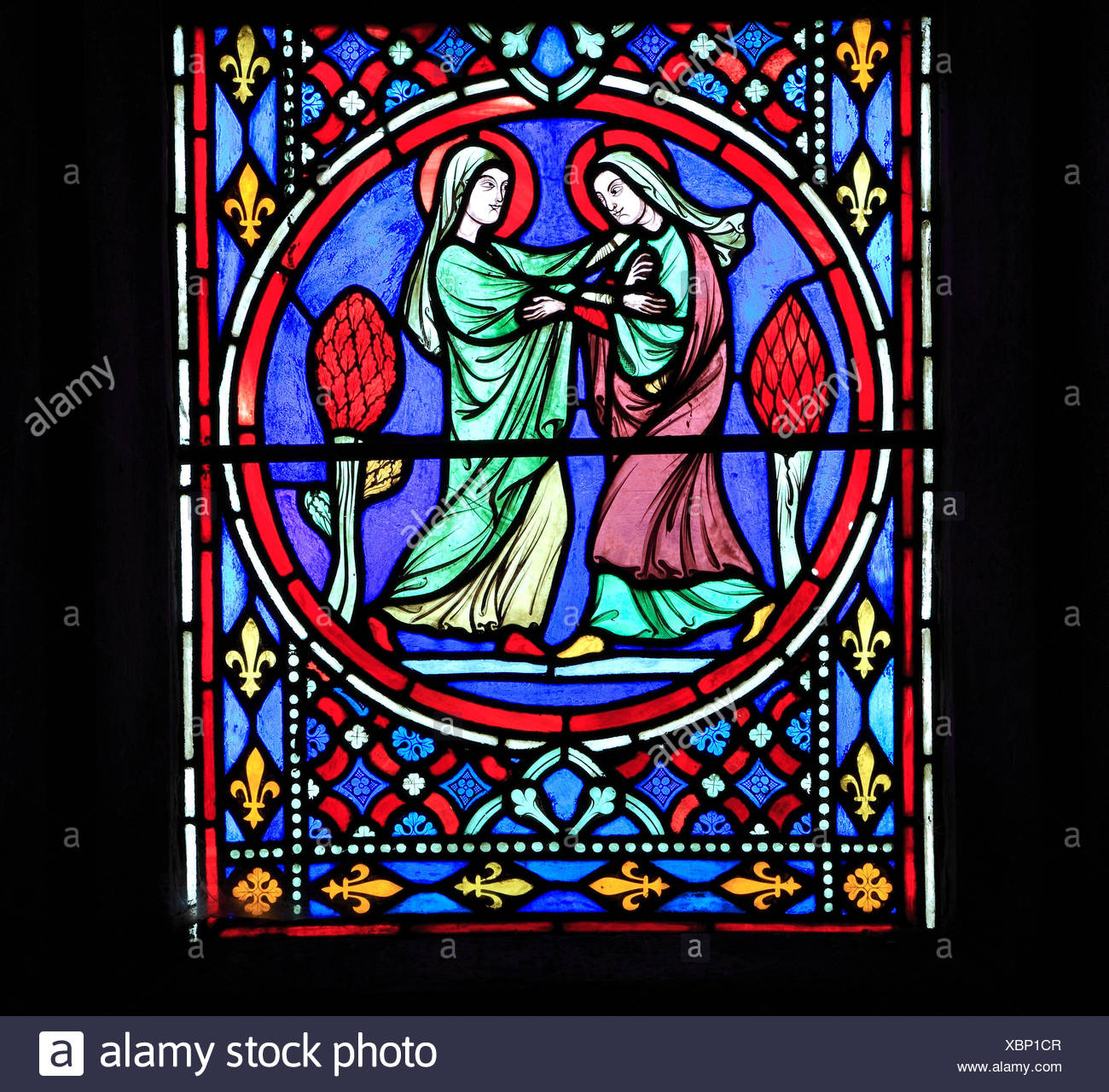 Nativity Window, stained glass by Oudinot of Paris, 1861, Feltwell Church, Norfolk, Visit of Virgin Mary to her cousin Elizabeth, visitation - Stock Image