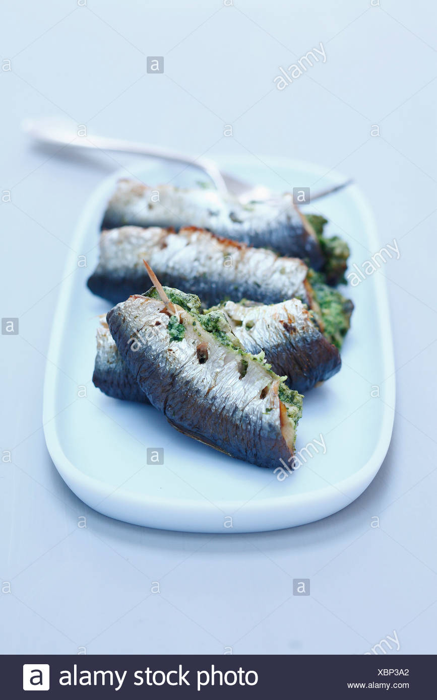 Grilled sardines stuffed with snail butter - Stock Image