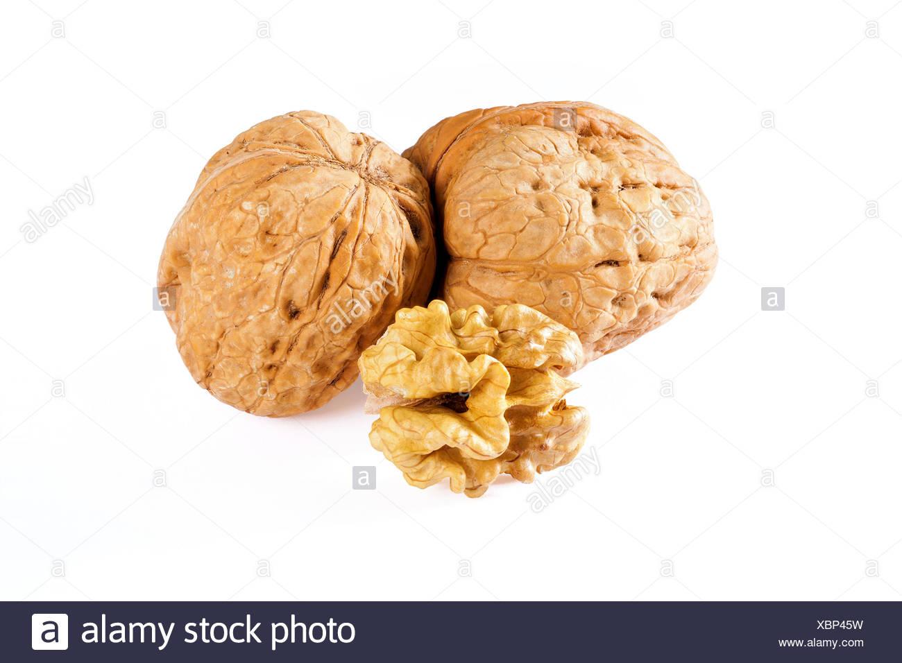 walnuts and walnut kernel - Stock Image
