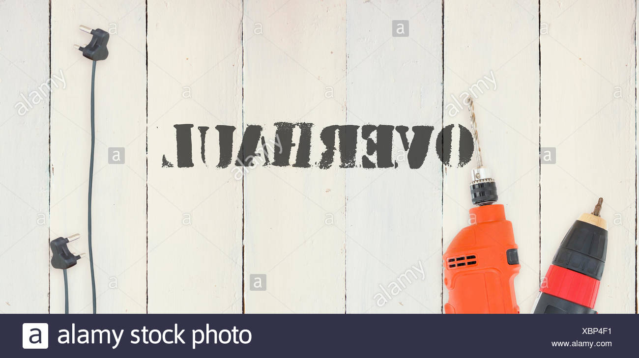 Overhaul against diy tools on wooden background Stock Photo