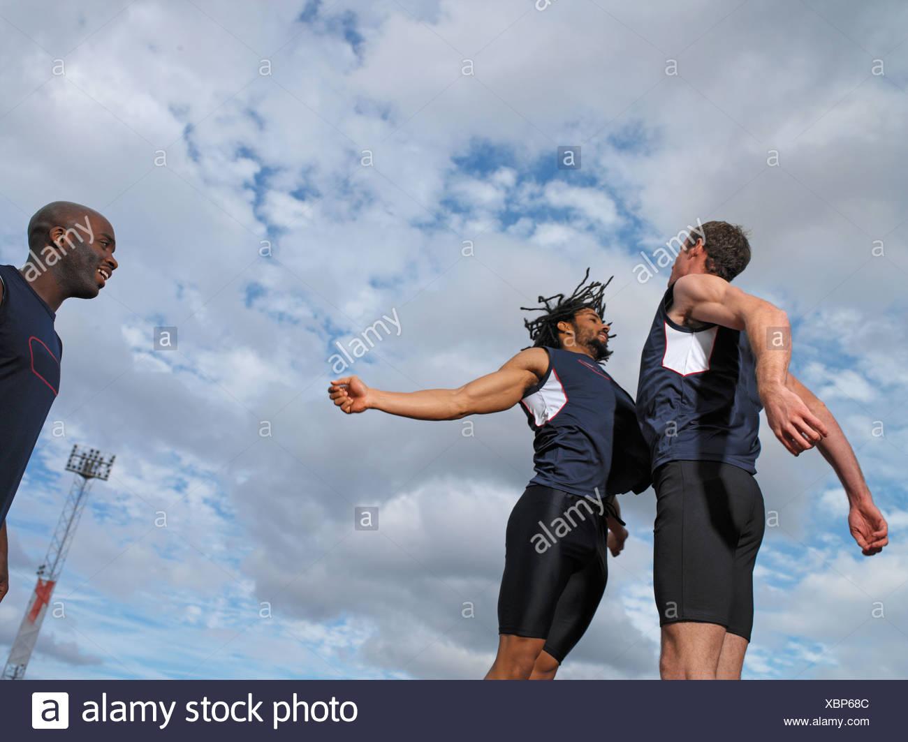 Male athletes celebrating - Stock Image