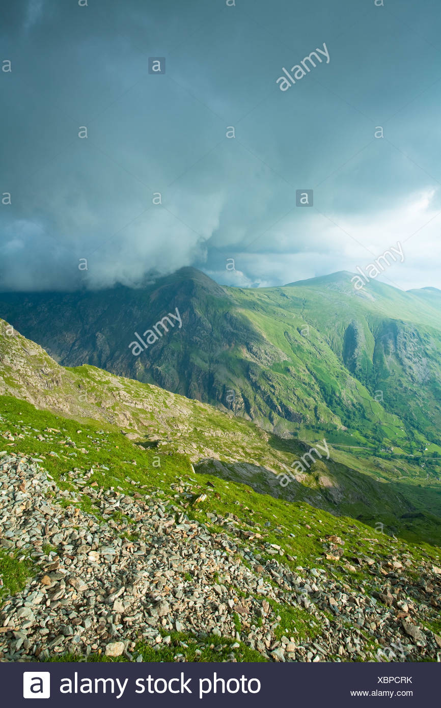 Storm clouds rolling in over Glyder Fawr taken from the Llanberis path close to Clogwyn Station on the slopes of Snowdon, Snowdo Stock Photo