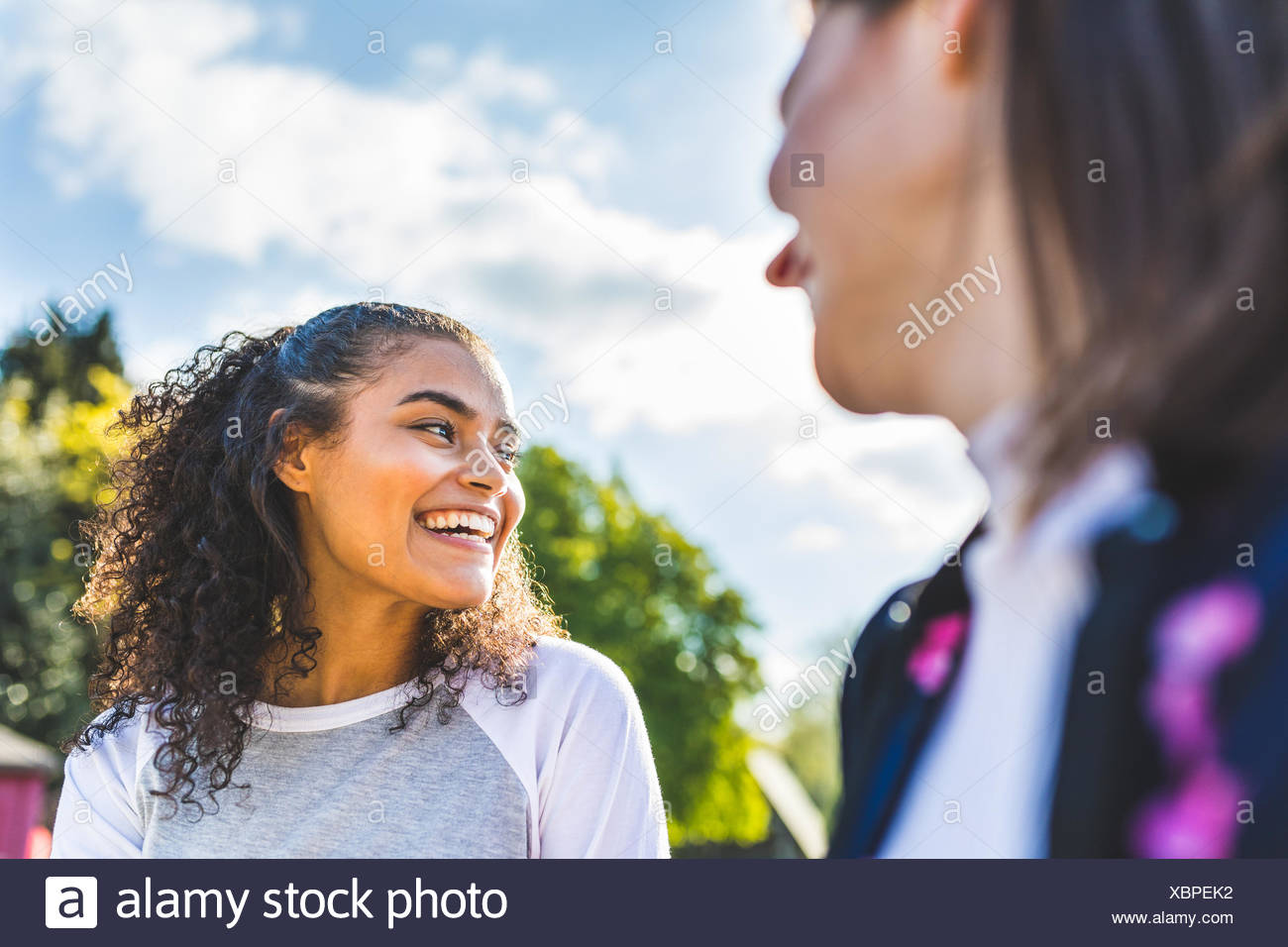 Two young female friends having fun in Battersea Park - Stock Image