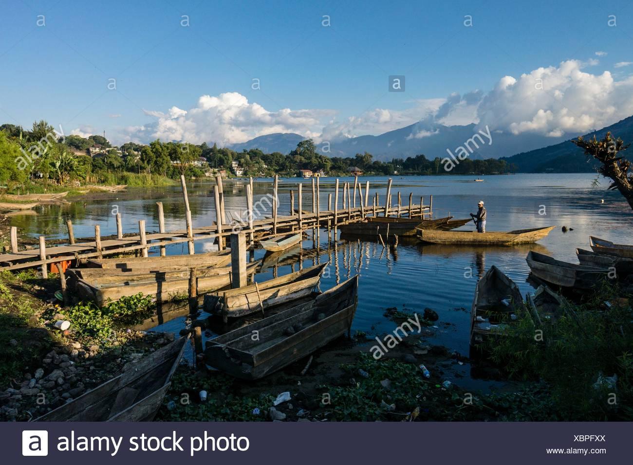 Canoes. Atitlan Lake. San Pedro Volcano. Santiago Atitlan, Solola Department, Guatemala - Stock Image