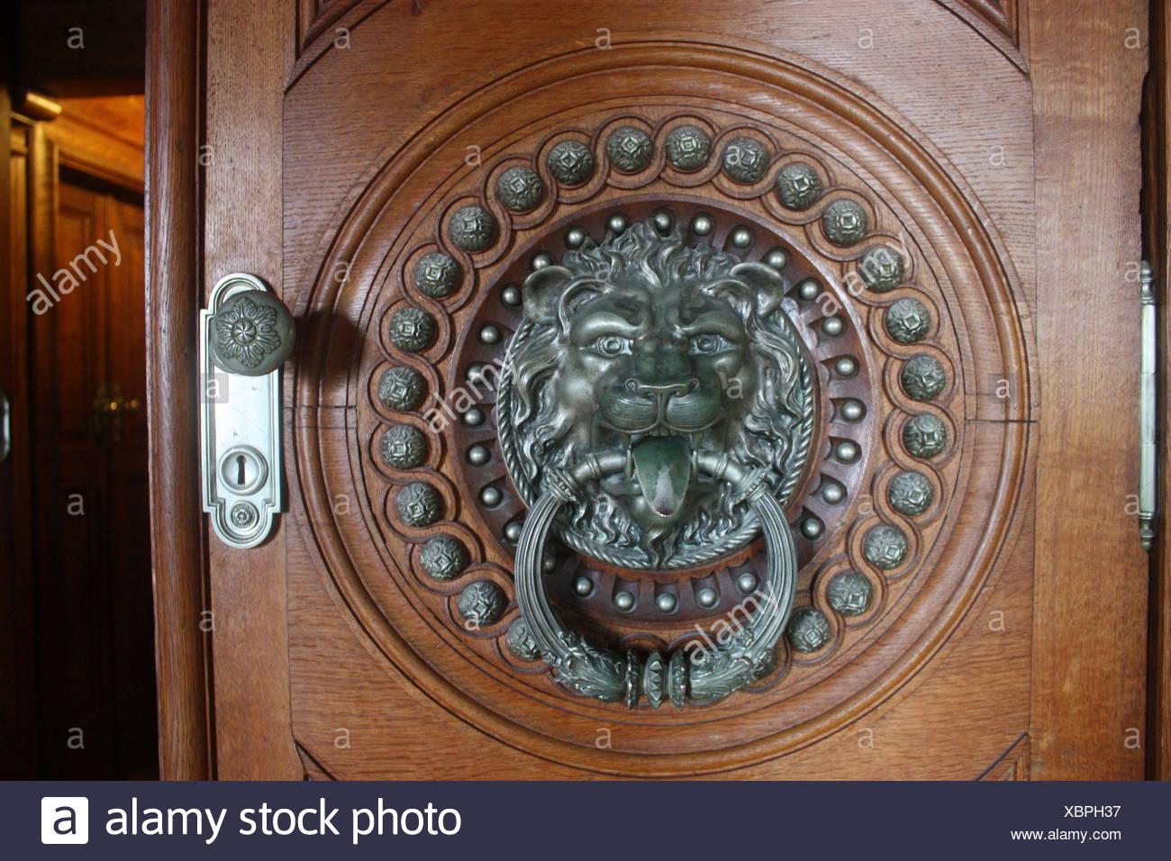 Silver Lion Shaped Knocker On Wooden Door   Stock Image
