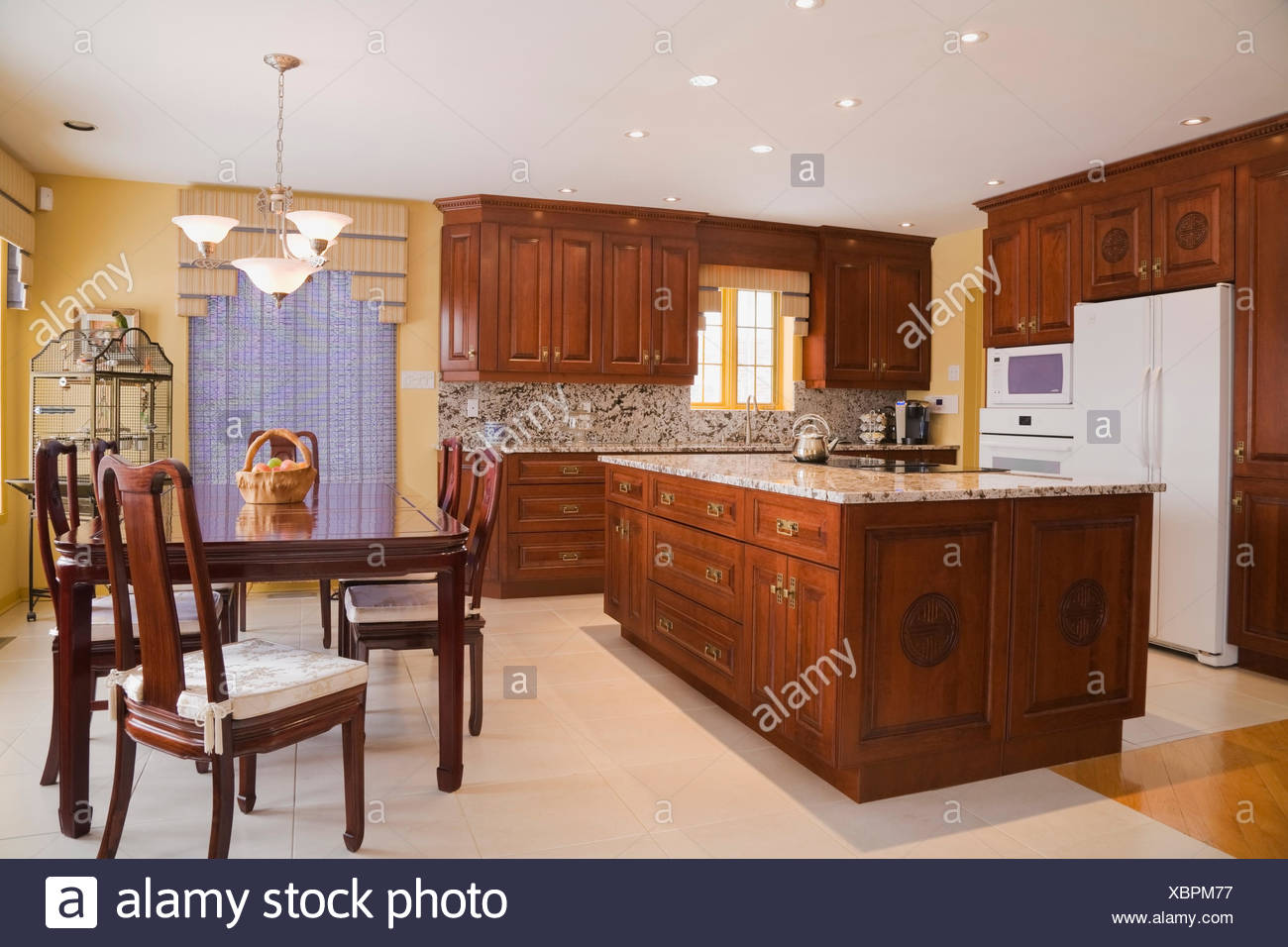 Classic style kitchen (Chinese influenced) with dining table ...