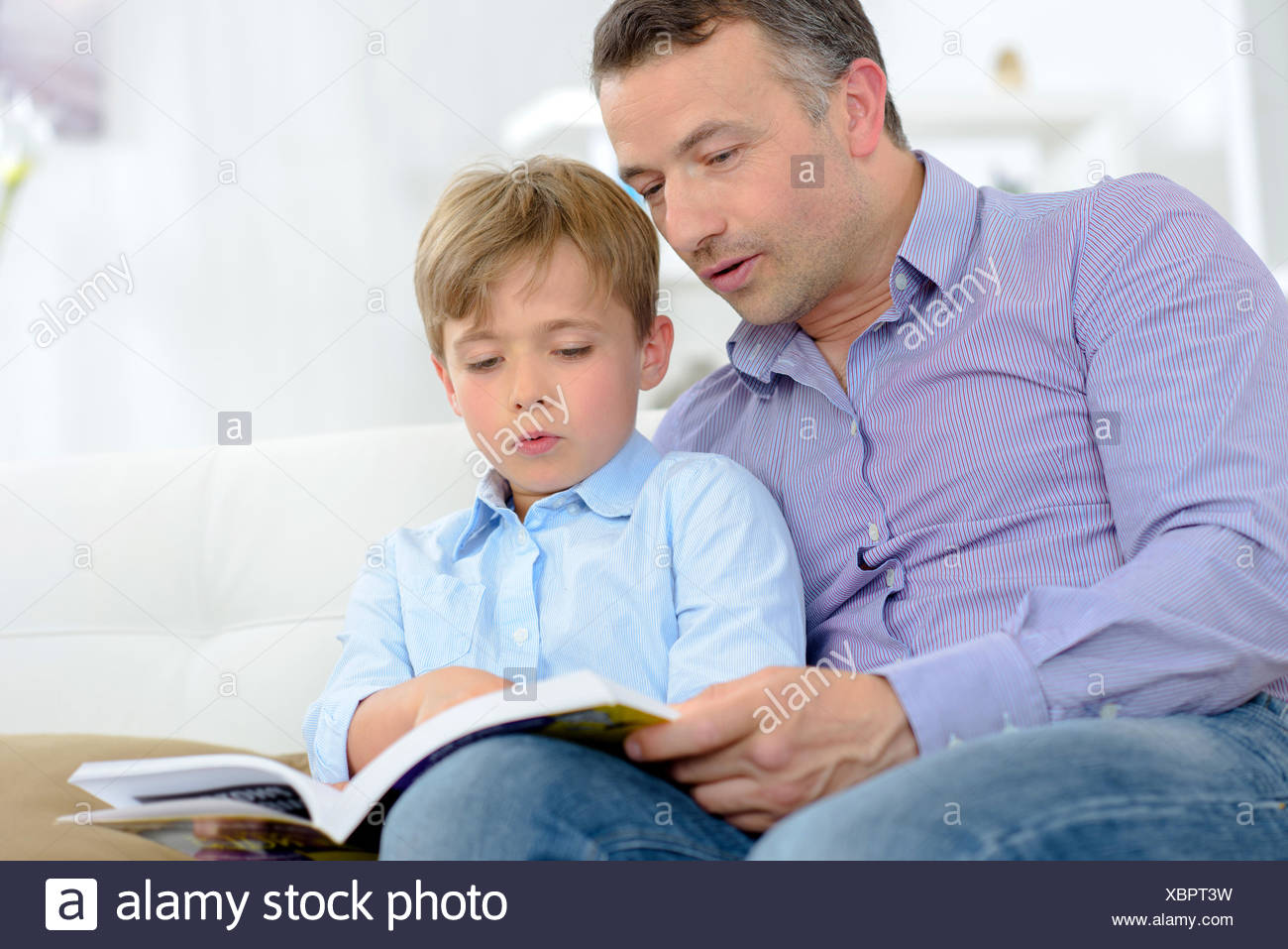 Adult and child reading - Stock Image