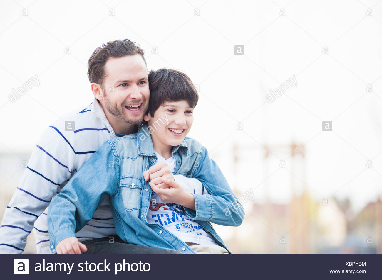Father and son hugging - Stock Image