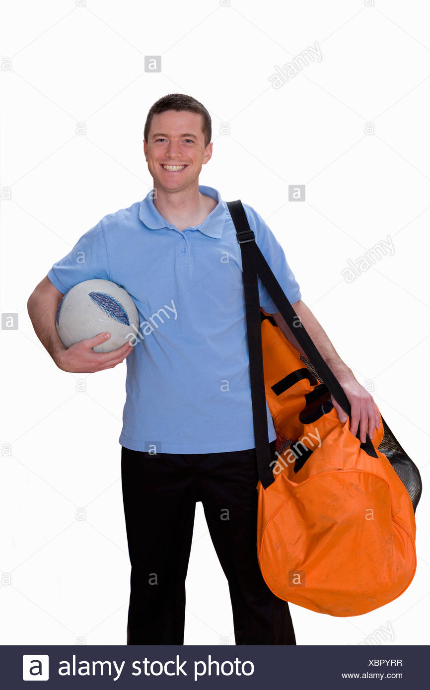 5c544eba5 Cut Out Of Male Soccer Coach With Bag Of Footballs Stock Photo ...