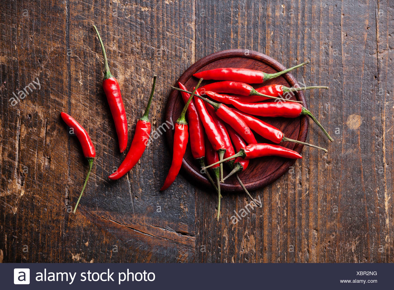 Red Hot Chili Peppers on wooden background - Stock Image