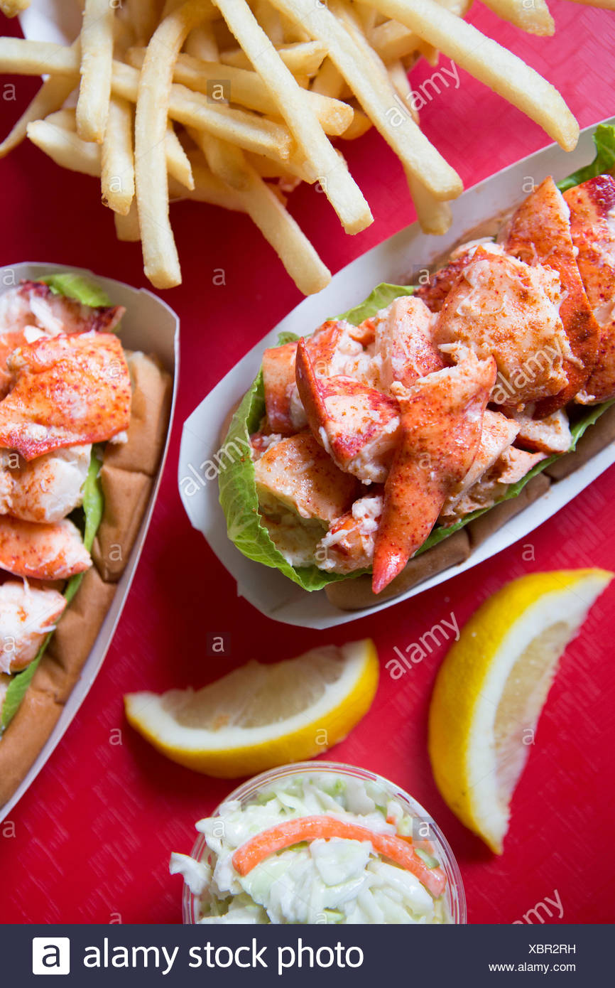 French fries, cold lobster roll and cole slaw at Arnold's Lobster and Clam Bar. - Stock Image