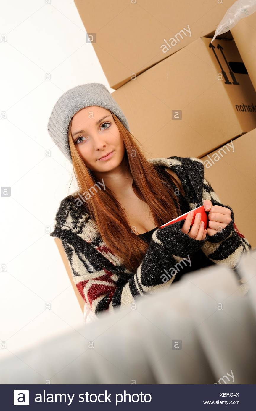 Young woman with packing cases Stock Photo