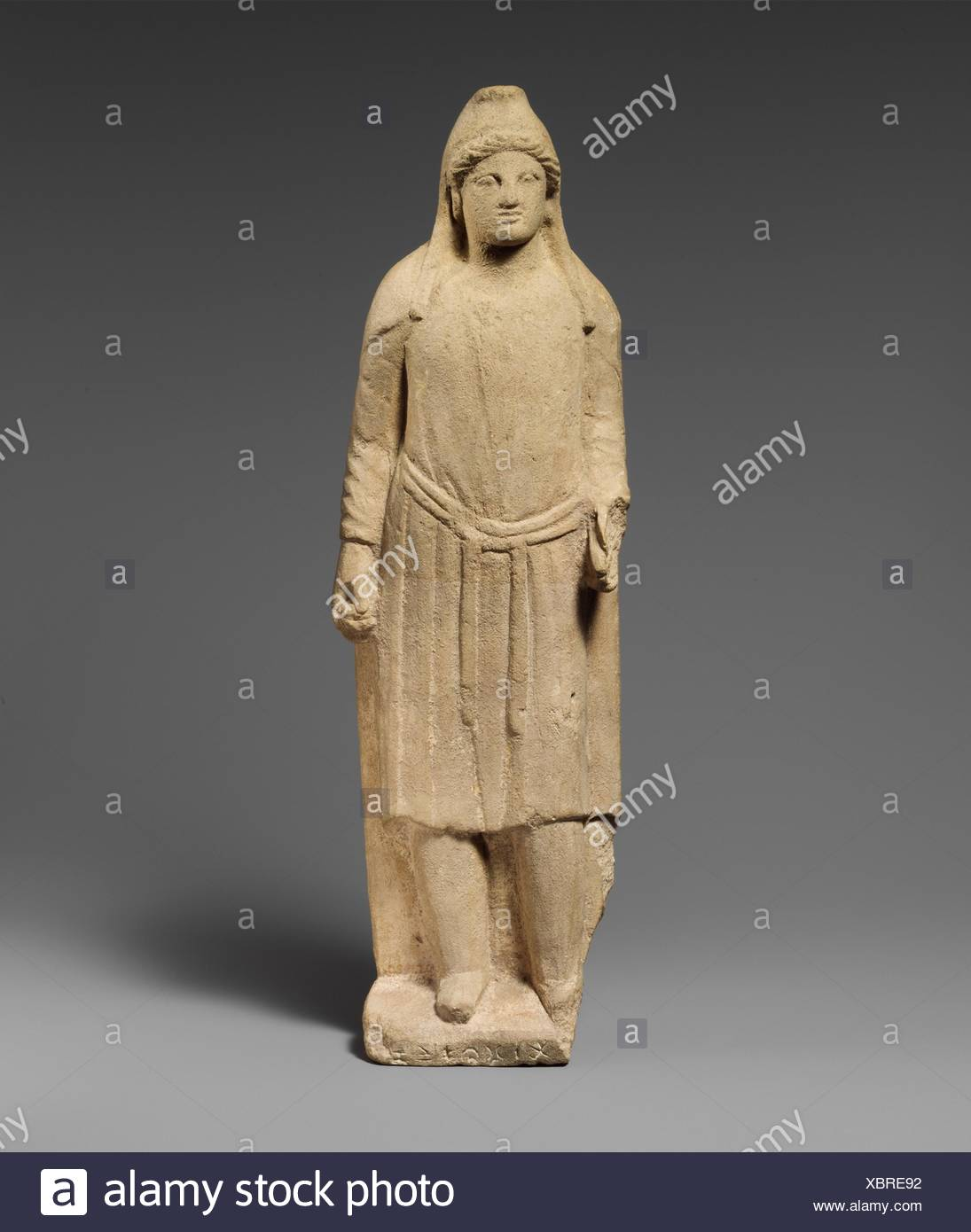 Limestone statuette of an oriental god or hero (?). Period: Early Hellenistic; Date: 3rd century B.C; Culture: Cypriot; Medium: Limestone; - Stock Image