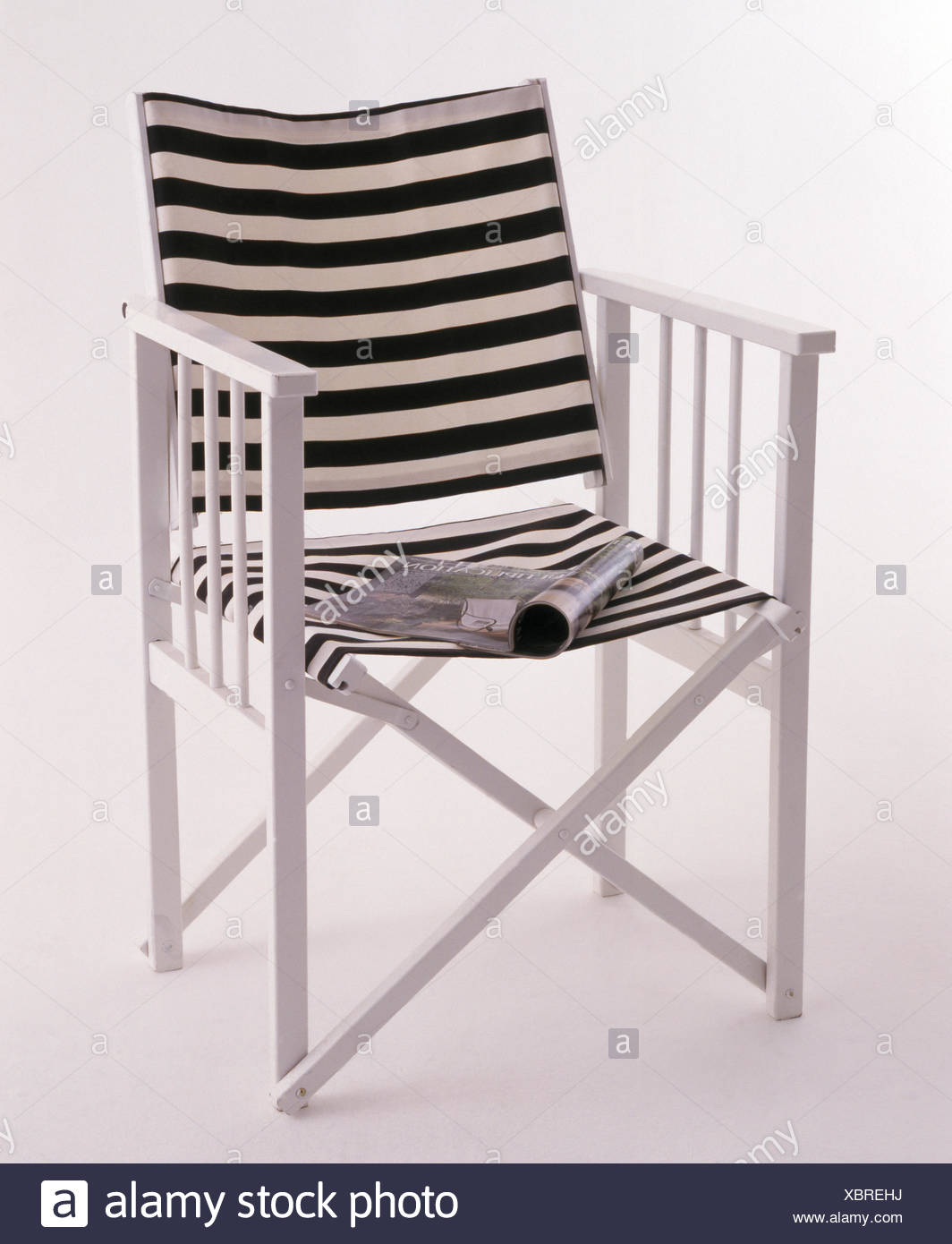 Director's chair with black+white striped canvas back and seat - Stock Image