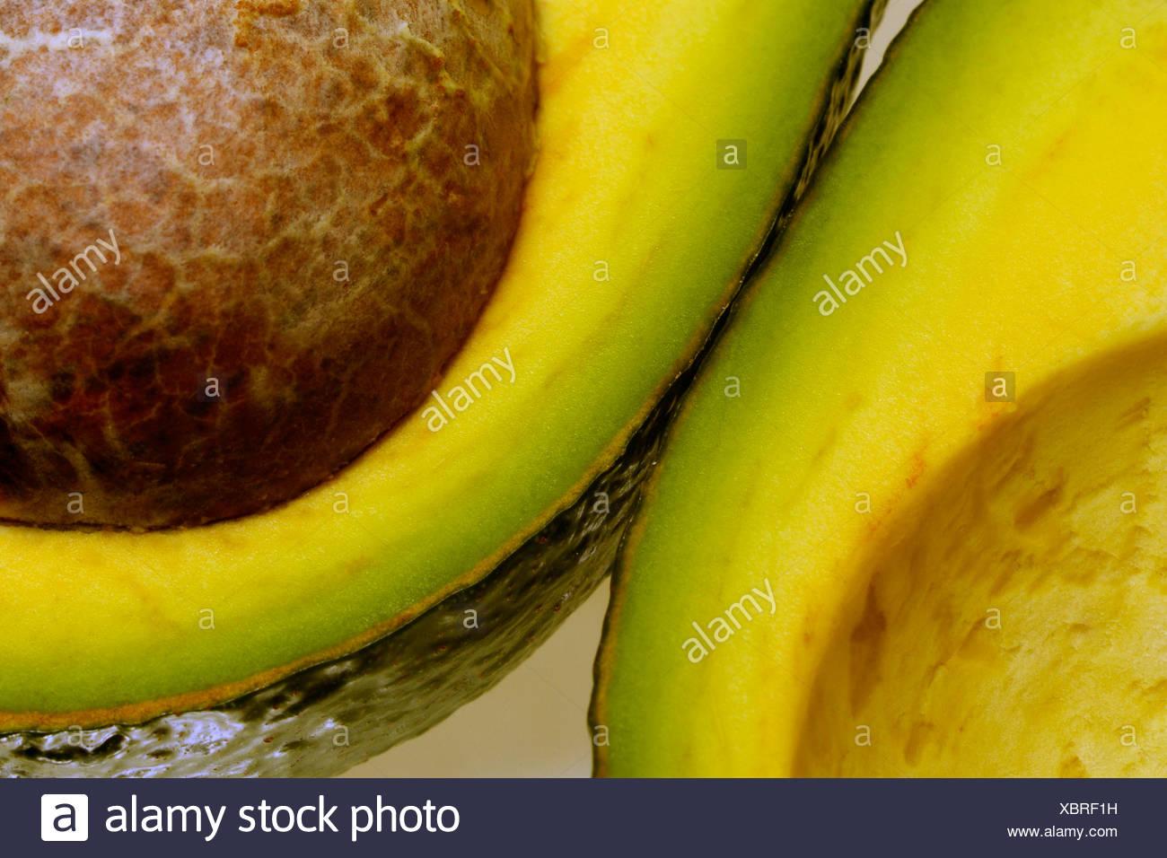 Cut open avocado - Stock Image